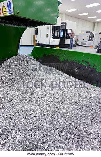 Bin of waste metal from engineering process in factory - Stock Image