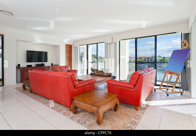 Stylish living room with canal views - Stock Image