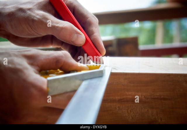 Carpenter using combination sqaure, Australia - Stock Image