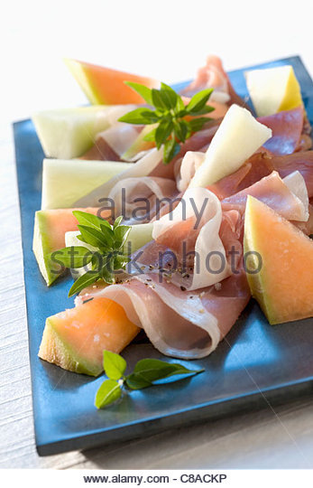 Melon,raw ham and basil - Stock Image