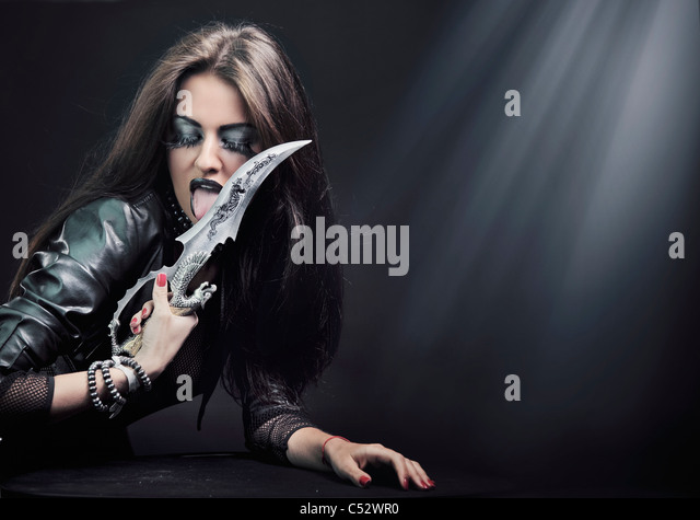 Attractive young woman with knife - Stock-Bilder