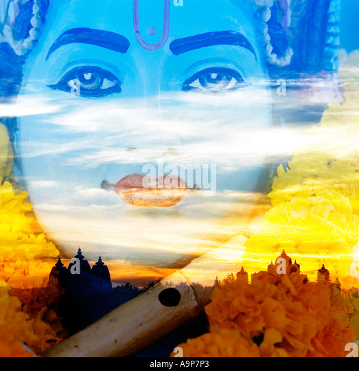 Krishna statue behind Indian architecture - Stock Image