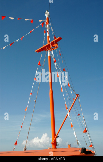 Tarpon Springs Florida Orange mast of traditional Greek sponge fishing boat - Stock Image