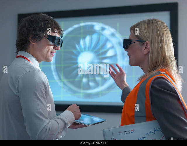 Scientists wearing 3D glasses in lab - Stock Image