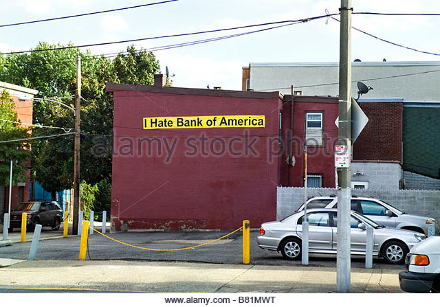 I Hate Bank of America written on banner attached to building in Philadelphia PA USA - Stock Image