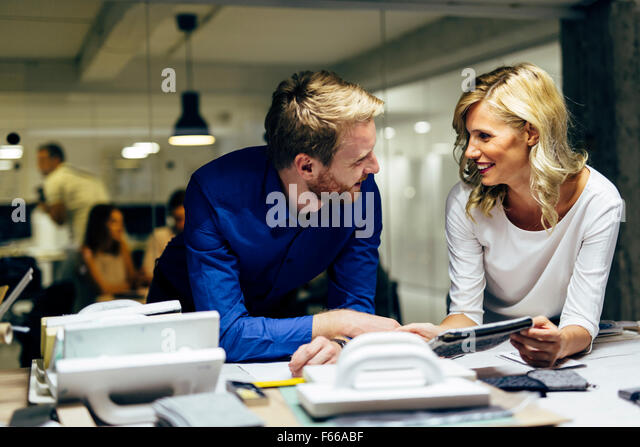 Two designers talking about possible trends ideas and new fashion styles. Teamwork - Stock Image