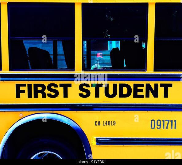 Yellow First Student Bus, California, USA - Stock Image