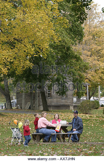 West Virginia Lewisburg Church Street family picnic trees fall colors - Stock Image