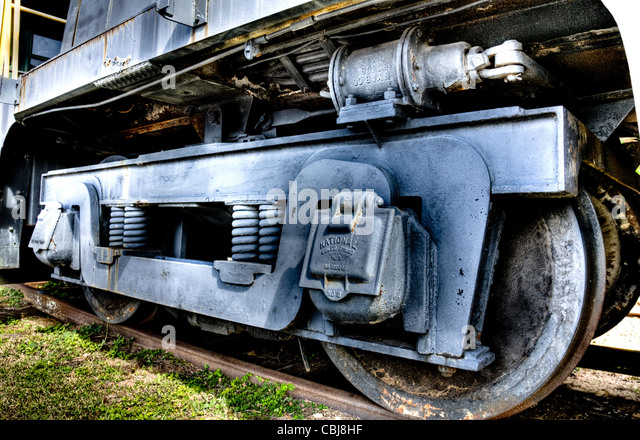 The wheels of a locomotive sitting on a track - Stock Image