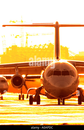 Commercial airplane in a queue for take off - Stock Image