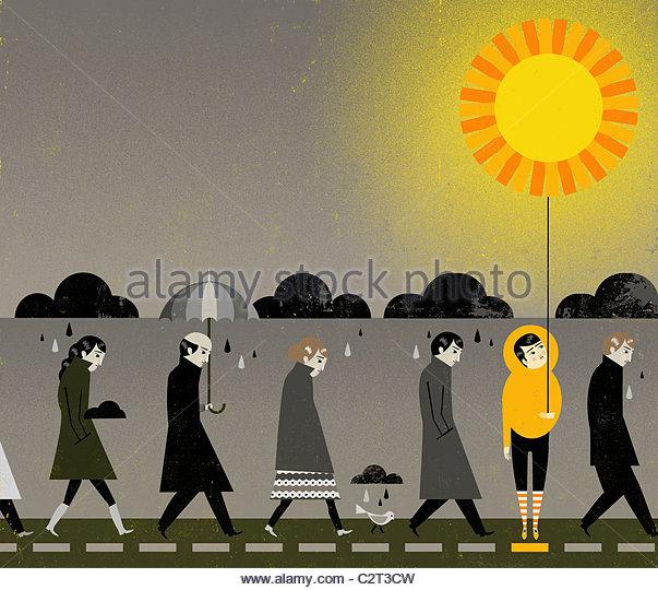 People under rain clouds, one holding sun-shaped balloon - Stock-Bilder