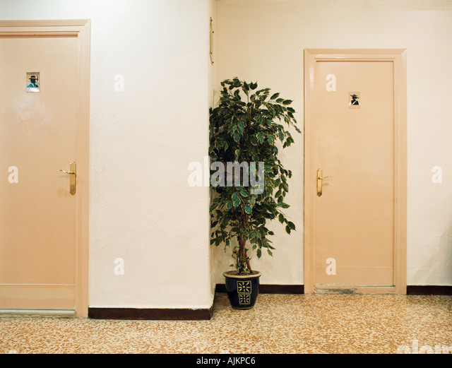 Ladies and mens restrooms - Stock Image