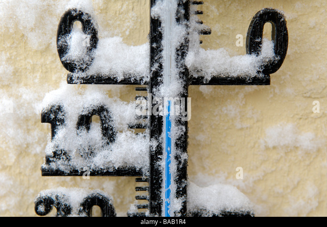 A thermometer covered with snow Sweden - Stock Image