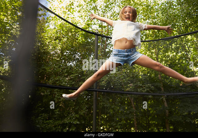 trampoline jump stock photos trampoline jump stock images alamy. Black Bedroom Furniture Sets. Home Design Ideas