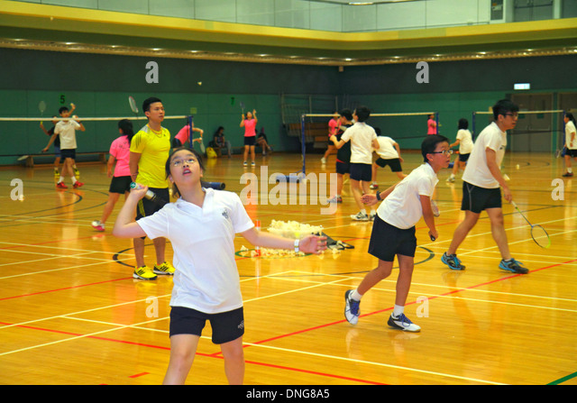 Hong Kong China Island Central Hong Kong Park Sports Centre center badminton courts indoor gymnasium Asian man teacher - Stock Image