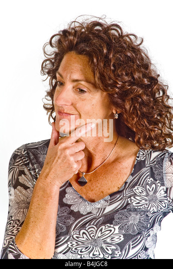 A woman s gesture of stroking her chin indicates decision making in body language terms - Stock Image