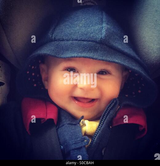 Child smiling in car seat - Stock-Bilder