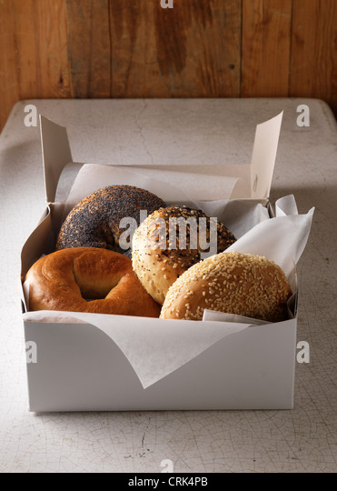 Box of various bagels - Stock-Bilder