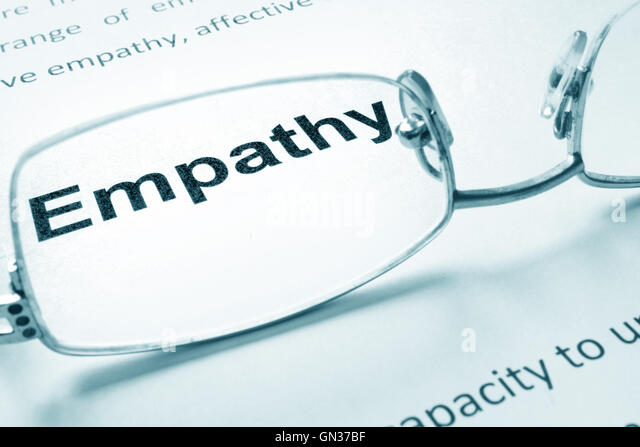 Empathy sign on a paper and glasses. - Stock Image