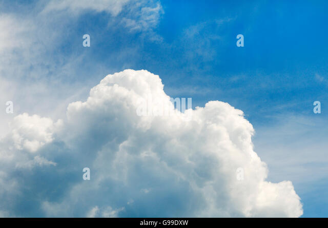 Puffy cumulus clouds mixed with blue sky - Stock Image