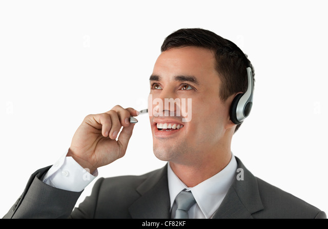 Close up of male professional with headset on - Stock Image