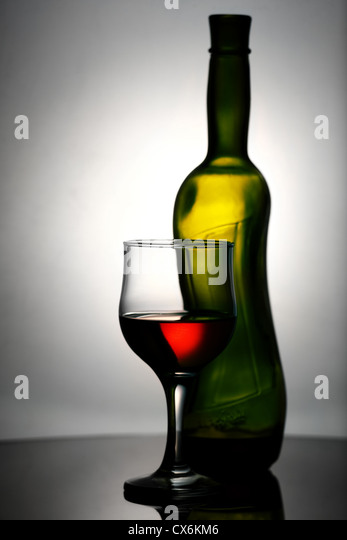 Abstract wine still life over grey backgrounds - Stock Image