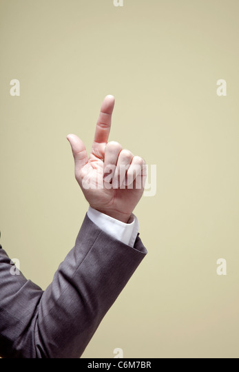 Business man hand pointing up - Stock Image