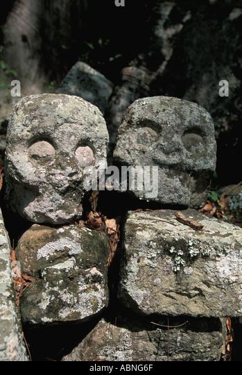 Honduras Copan Ruinas vertical Mayan ruins stone skulls temple 7 death and sacrifice symbols - Stock Image
