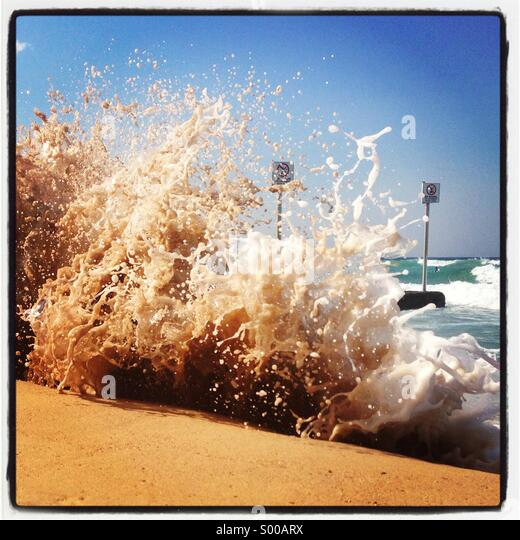Large foamy waves on Manly beach, Sydney, nsw, Australia - Stock Image