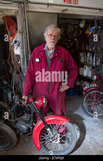 Classic motorcycle dealer Any Tiernan in a red boiler suit - Stock Image