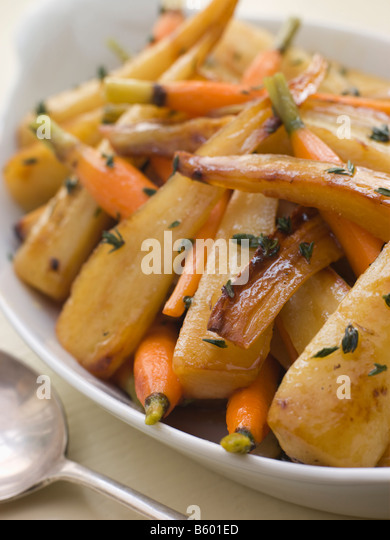 Parsnips and Baby Carrots Roasted in Thyme and Honey - Stock Image