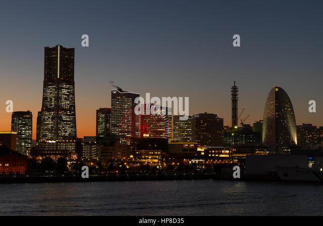 Landmark Tower and Minato Mirai skyline at sunset. Sakuragicho, Yokohama, Kanagawa, Japan. Friday February 3rd 2017 - Stock Image
