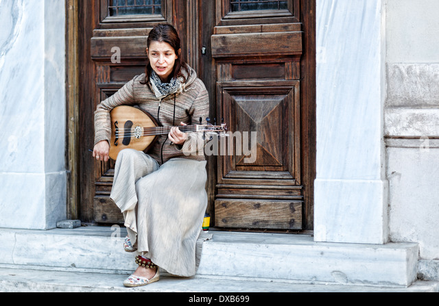 A musician playing in the street of Athens, Greece - Stock Image