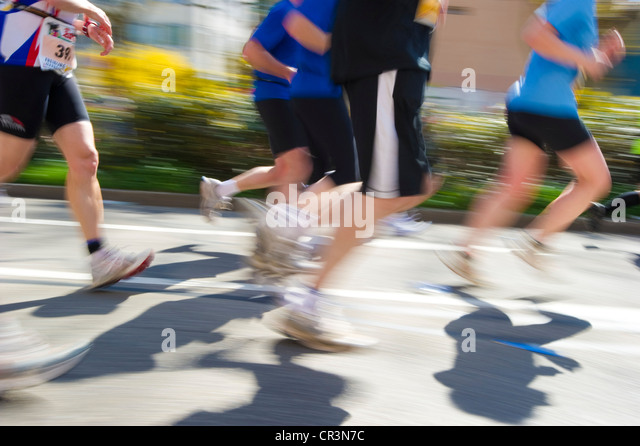 Marathon runners, motion blur, Freiburg Marathon, 3 April 2011, Freiburg im Breisgau, Baden-Wuerttemberg, Germany, - Stock Image