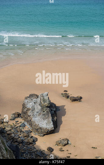 The beach at Bedruthan Steps on the northern coast of Cornwall in England, UK - Stock Image