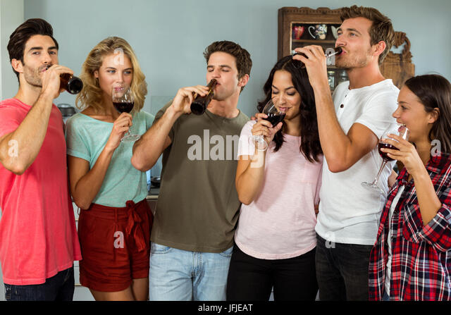 Friends Drinking Alcohol At Home Stock Photos & Friends ...