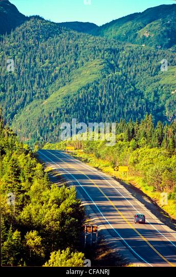 Van travelling through Gros Morne National Park, Newfoundland and Labrador, Canada. - Stock Image