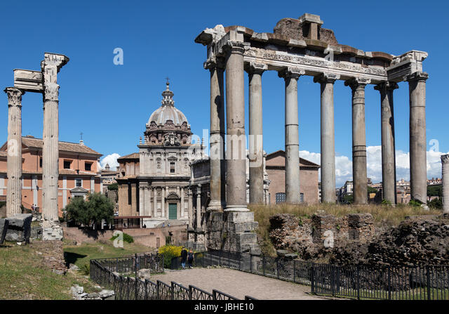 The Temple of Saturn and (on left) the Temple of Vespasian and Titus in the Roman Forum in the city of Rome, Italy. - Stock Image