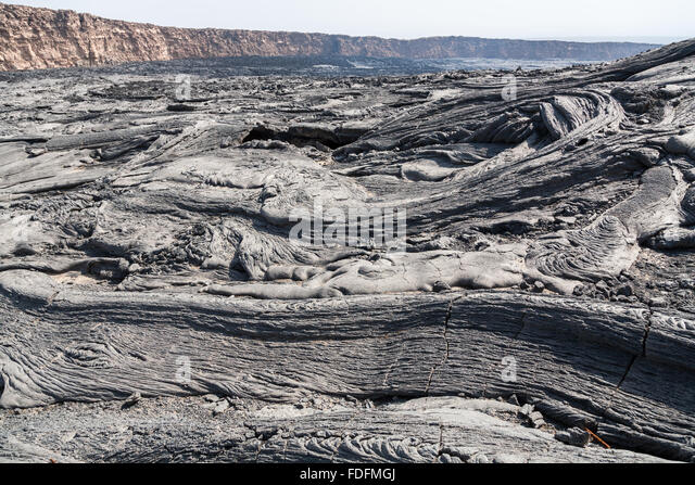 Swirls of grey basalt lava fill the caldera at the summit of Erta Ale volcano in Ethiopia - Stock Image