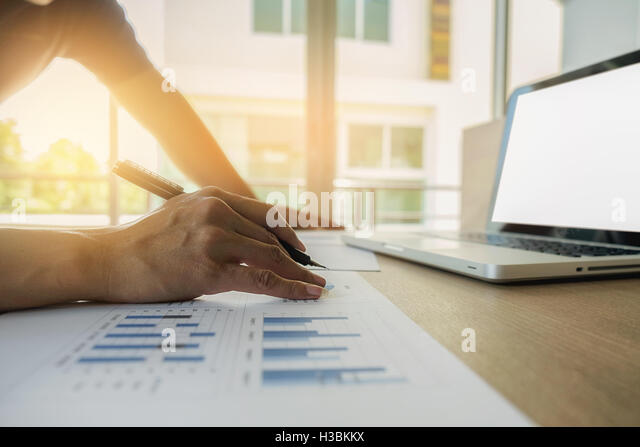 accounting,business,discussing,successful,teamwork,documents,economics,working, workplace,meeting, paper, paperwork - Stock Image