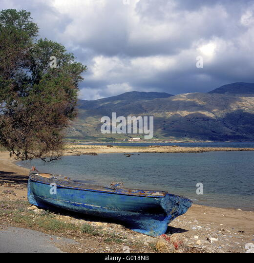 old fishing boat at the beach of Crete Island, - Stock Image
