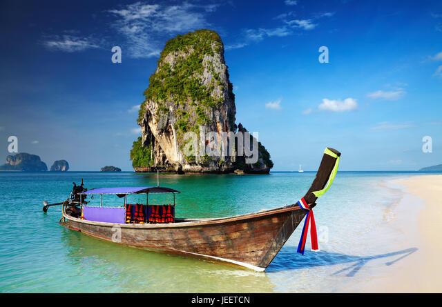 Tropical beach, longtail boat, Andaman Sea, Thailand - Stock Image
