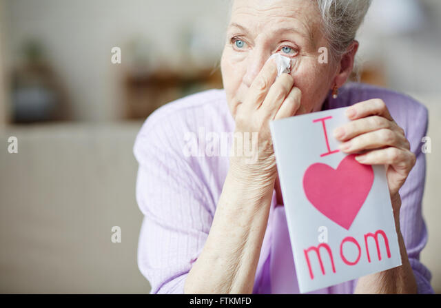 Wiping tears - Stock Image