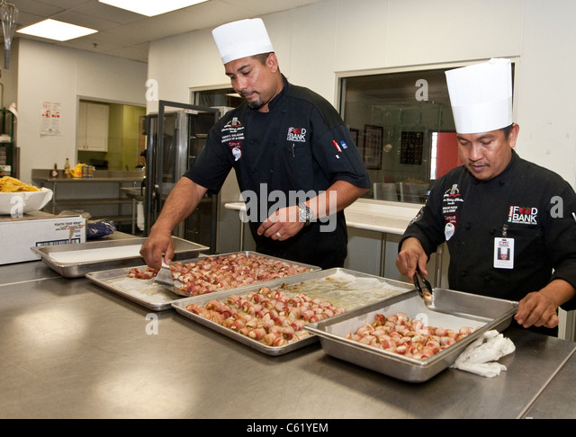 Chefs work in the kitchen of the San Antonio Food Bank in San Antonio, Texas - Stock Image