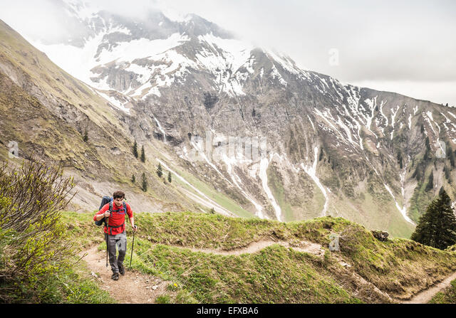 Young man mountain trekking, Oberstdorf, Bavaria, Germany - Stock-Bilder