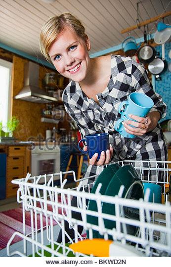 Girl sorting dish - Stock Image