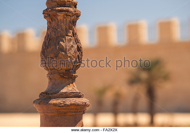 Rust rusty corrosion, a corroded iron lamp post on Ortygia Island, Syracuse, Sicily. - Stock Image