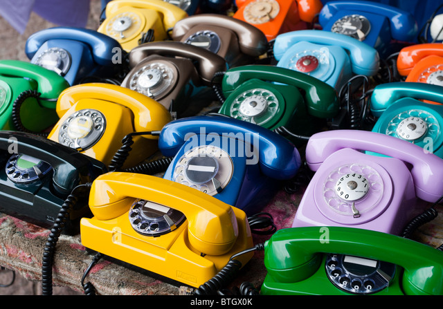 Colorful rotary dial telephones - Stock Image