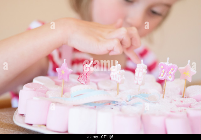 Girl examining decorated candies - Stock Image