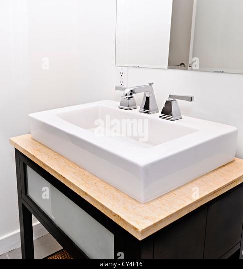 Closeup interior of bathroom vanity and mirror - Stock Image